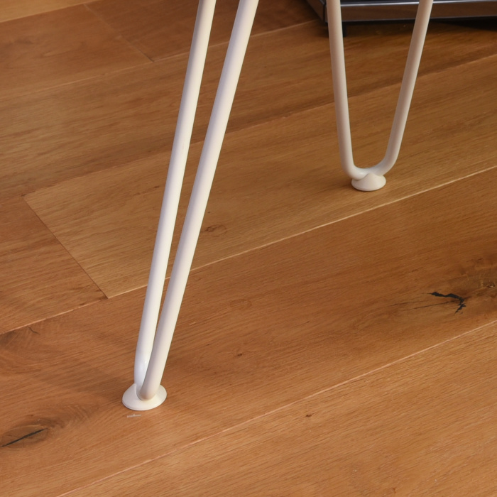White hairpin legs on an oak floor